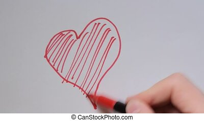 Hand write I love you on a white board with a red pen.