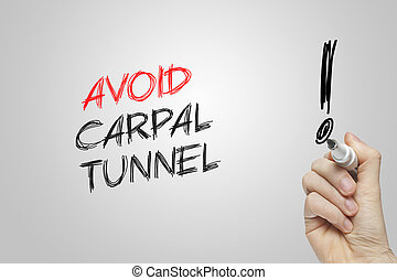 Hand writing avoid carpal tunnel on grey background
