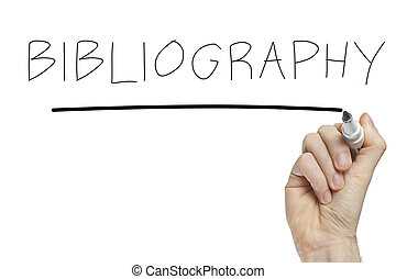 Hand writing bibliography on a white board