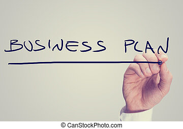 Hand writing business plan on a virtual screen