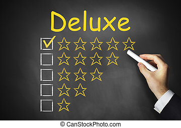 hand writing deluxe on chalkboard rating stars - hand...