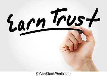 Hand writing Earn Trust with marker