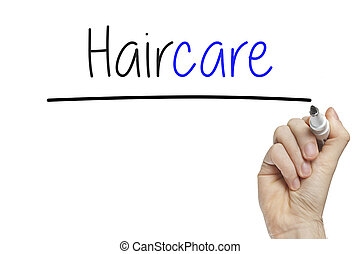 Hand writing hair care on a white board