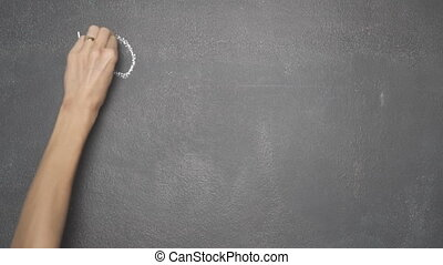 """Hand writing """"HOW TO INVEST MY MONEY?"""" on black chalkboard -..."""