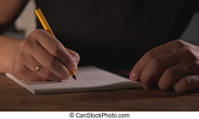 hand writing in notebook - man hand writing something in...