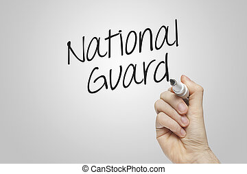 Hand writing national guard on grey background