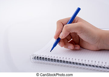 Hand writing on a Notebook