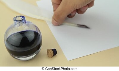 Hand writing on parchment with quill pen and glass ink...