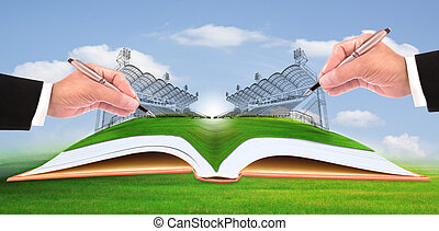 hand writing stadium on green grass use for construction and...