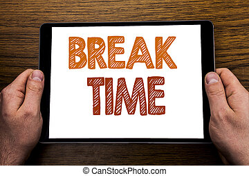 Hand writing text caption Break Time. Business concept for Stop Pause From Work Workshop Written on tablet laptop, wooden background with businessman hand, finger holding PC.