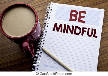 Hand writing text caption inspiration showing Be Mindful....