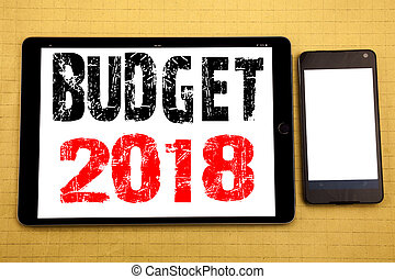 Hand writing text caption inspiration showing Budget 2018. Business concept for Household budgeting accounting planning Written on tablet laptop, wooden background with sticky note, coffee and pen