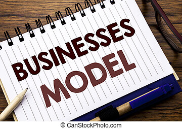 Hand writing text caption inspiration showing Businesses Model. Business concept for Project For Business Written on notebook note paper, wooden background with glasses pen and marker.