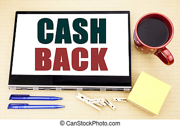 Hand writing text caption inspiration showing Cash Back Cashback. Business concept for Money Assurance written on tablet laptop. Office place with coffee cup, pen and sticky note.