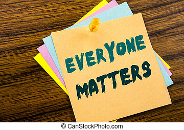 Hand writing text caption inspiration showing Everyone Matters. Business concept for Equality Respect written on sticky note paper on the wooden background.