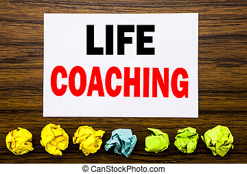 Hand writing text caption inspiration showing Life Coaching. Concept for Personal Coach Help Written on sticky note , with sticky, one folded paper alone for difference or collaboration