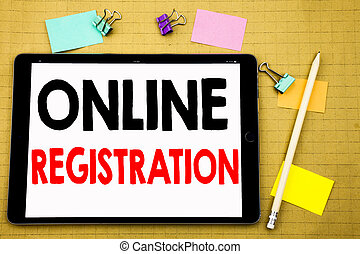 Hand writing text caption inspiration showing Online Registration. Business concept for Internet Login Written on tablet laptop, wooden background with sticky note and pen