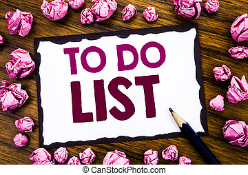 Hand writing text caption inspiration showing To Do List. Business concept for Plan Lists Remider Written on sticky note paper, wooden background with folded pink paper meaning thinking