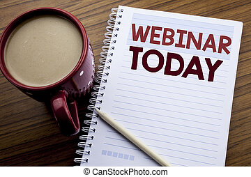 Hand writing text caption inspiration showing Webinar Today. Business concept for Online Education Event written on note paper notepad book on the wooden background with coffee and pen.