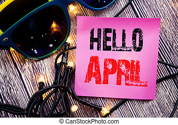 Hand writing text caption showing Hello April. Business concept for Spring Welcome written sticky note empty paper background with copy space with sunglasses