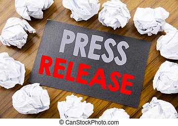 Hand writing text caption showing Press Release. Business concept for Statement Announcement Message written on sticky note paper on the wooden background with folded paper meaning thinking