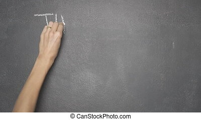 "Hand writing ""THINK OUTSIDE THE BOX"" on black chalkboard"