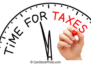 Time for Taxes - Hand writing Time for Taxes concept with...