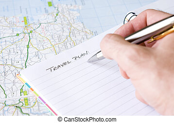 Hand writing travel plan in a lined spiral notepad arranged...