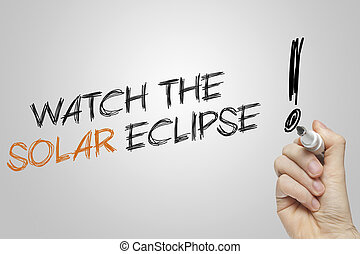 Hand writing watch the solar eclipse