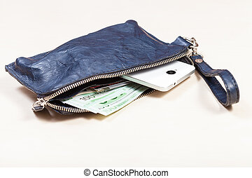open blue leather wristlet purse bag with credit cards, smartphone and euro banknotes on pale brown table