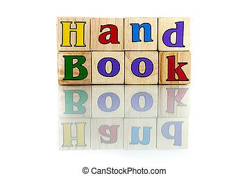 handbook - handbook colorful wooden word block on the white...