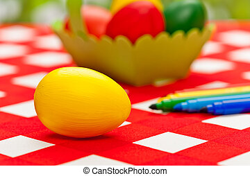 Handcrafted easter eggs with green egg basket