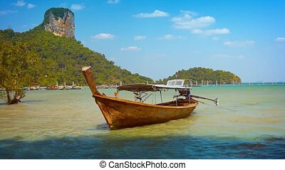 Handcrafted Longtail Boat Anchored in the Tropical Shallows...