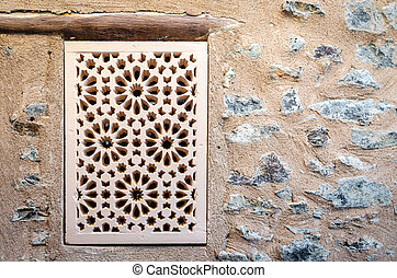 Handcrafted Window on Stone Wall