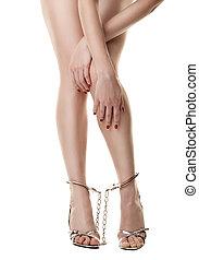 Handcuffed female legs - A pair of long handcuffed female...