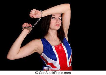 Handcuffed girl in a Union Jack dress