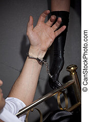 Handcuffed - Man handcuffed to the bed by sexual games