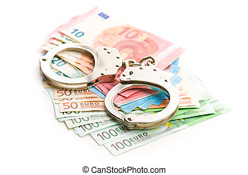 Handcuffs and euro money.