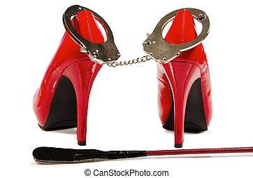 Handcuffs and high heels - Handcuffs, riding crop and high...
