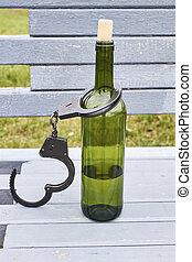 Handcuffs locked bottle