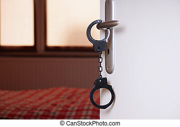 handcuffs on bedroom door handle