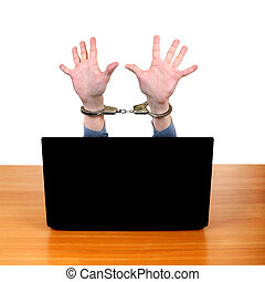 Handcuffs on Hands behind Laptop