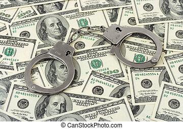 Handcuffs on money background