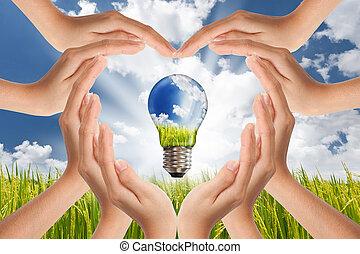 handen, besparing, globaal, concept, van, groene, energie, oplossingen, met, gloeilamp, en, planeet, op, helder, landscape
