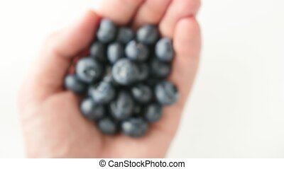 handful of freshly picked blueberries isolated on white -...