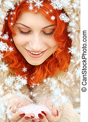 handful of ice and snowflakes - lovely redhead in fur with...