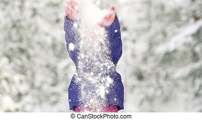 Handful Of Snow - Lovely little girl throwing a handful of...