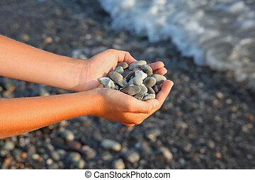 Handful of stones in hands