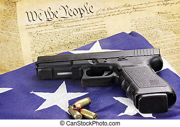 Handgun and Constitution - A 45 caliber handgun and...