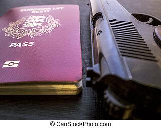 Handgun and passport